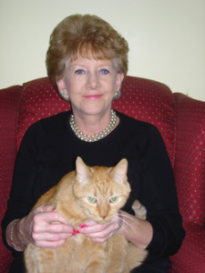 Chrisalin owner Ellen Johnson at home with her cat.
